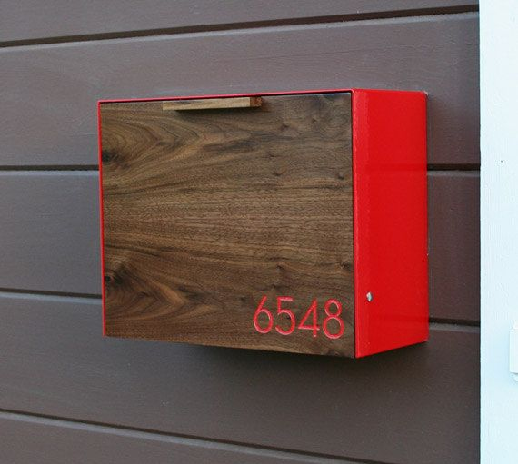 CUSTOMIZABLE - for keys (with lock?) This Stainless Steel and Walnut mailbox measures 14.5W x11.5H x 6D. I designed this mailbox after the 1950s black mailbox that used to hang on my                                                                                                                                                                                 More