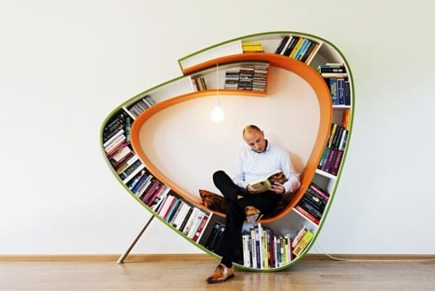 Cozy Reading Chair Surrounds User With Their Books