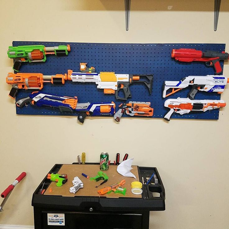I figured that since I have to share my shop with my son I hung up his nerf guns.