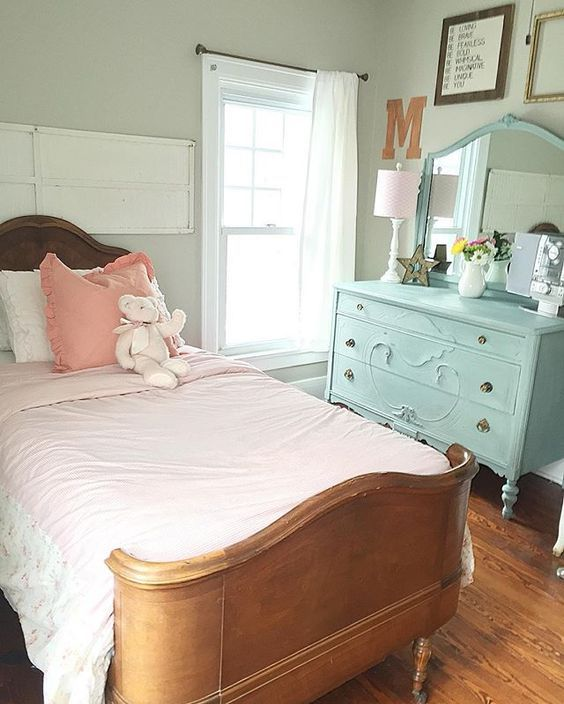 Such a cute farmhouse girls bedroom - love the antique bed and the painted blue dresser eclecticallyvintage.com