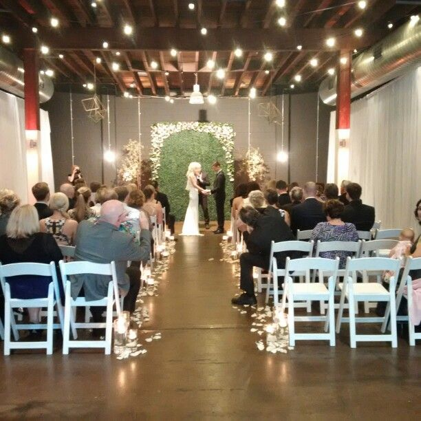 Stunning warehouse wedding ceremony by Fashionable Society Events