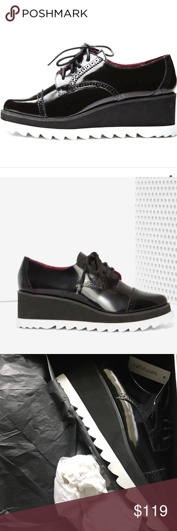 """Sixty Seven Harper Leather Oxford The Harper is round toe patent leather oxford with wingtip detailing. White rubber platform with wedge heel. Heel Height: 3"""" Nasty Gal Shoes"""