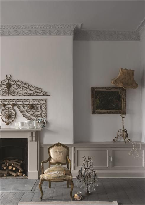 Living room with walls in Wevet Estate Emulsion, trim and fireplace in Purbeck Stone Estate Eggshell and floor in Downpipe Floor Paint An inspirational image from Farrow and Ball