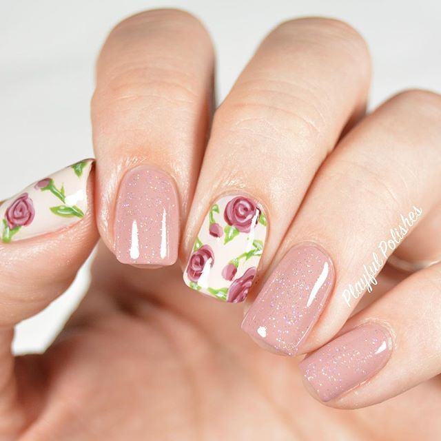 Nude floral manicure. Check out www.lapaloma-boutique.com for lots of floral nail decals