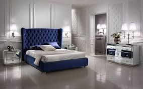 Voque  luxury bed with high headboard in capitone composed of  elegant night tables and dresser in mirror. Highlights the appliques Egoist.