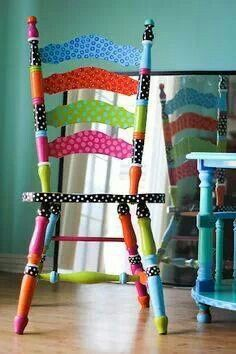 Love this painted chair.  Fun and cheerful. Colors make me happy. (will need to add puRple.) It would be fun to paint patterns like I have done on boxes in the past.