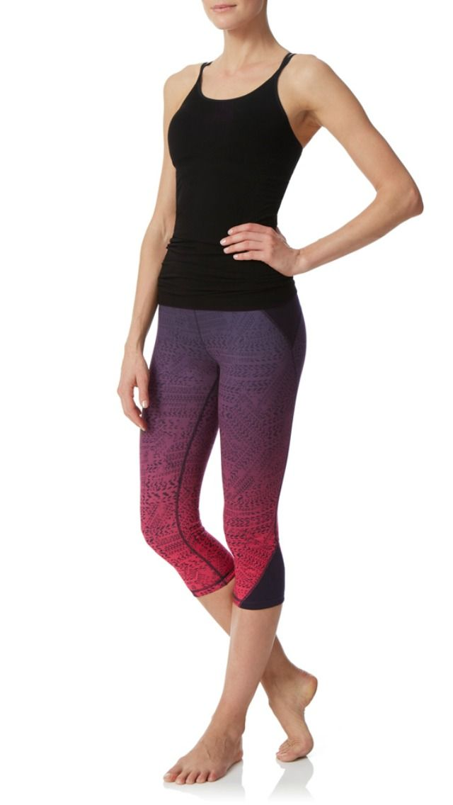 add a bit of color to your yoga practice with these printed ombre yoga capris in a versatile design you can reverse to black, featuring this season's ultra edgy track print.
