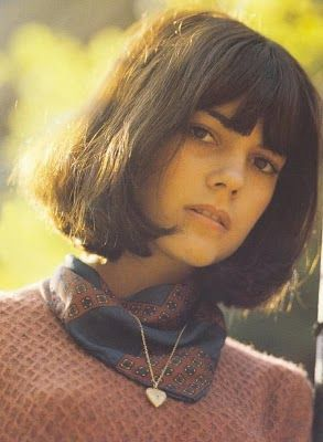 Chantal Goya. She makes me want to be more on top of trimming my bangs.