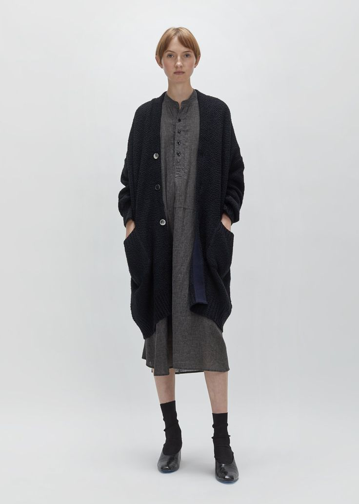 Black cotton oversized knit cardigan with pearlized grey buttons. Oversized fit. Dropped shoulders. Patch pockets. Color: Black. 100% Cotton. Made in Japan. Fit
