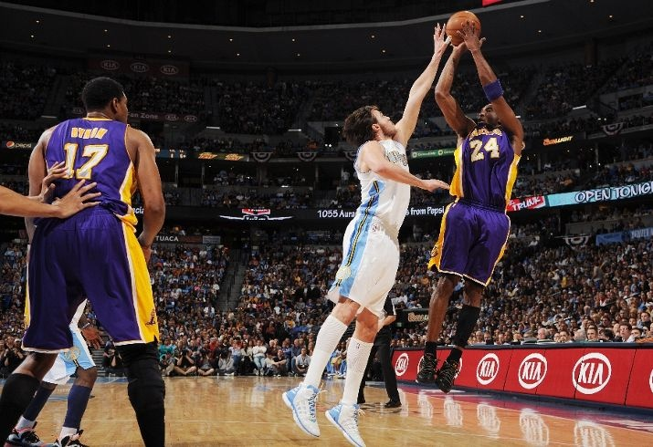 Kobe hits a a bucket with a hand in his face