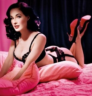 Dita Von Teese... forget what she is wearing (or not wearing lol) I LOVE & WANT her hair!!!