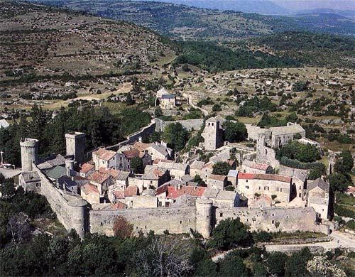 La Couvertoirade is a Knights Templar fortress and dates to 12th century. Located north of Narbonne and west of Nimes in the Languedoc-Roussilon region. The cross of the order of Malta adorn the keystones of St. Christophe Church, and outside of the church is a Templar graveyard.