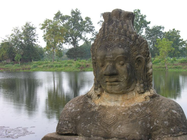 Guardian at the entrance to Beng Melea temple, moat in the background. Off the beaten track !