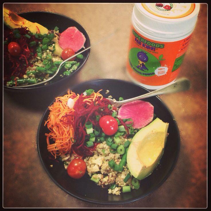 Yummy lunch at the Nutra Organics office ) cauliflower rice , salad & avocado . Topped w/ vital veggie powder .