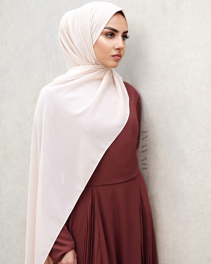 "INAYAH | THE AALIYAH EDIT: ""Colours and textures appeal to me when purchasing clothing. Does anyone else walk past an outfit and visualise themselves wearing it and deciding what colour hijab would match? ….I love wearing traditional dresses and I'm always open to trying new clothing."" Rust Gown with Pleated Inserts Oatmeal Soft Crepe Hijab www.inayah.co"