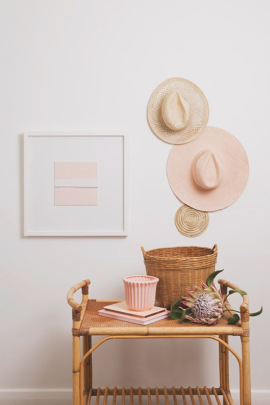 nude tones with natural bamboo and straw, hats on wall, bamboo trolly bar cart, pale art