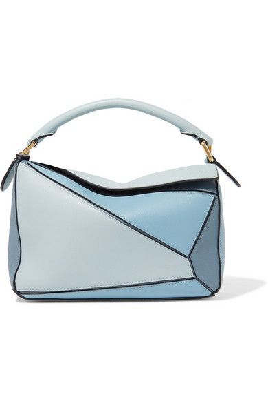 Loewe's 'Puzzle' bag was Creative Director Jonathan Anderson's first design for the label and remains one of its most sought-after styles. Each one is made using over 524 separate steps and hand-sewn by skilled artisans in the label's Spanish atelier. Made from supple leather in tonal shades of blue, this small version has a spacious canvas-lined interior and an outer zipped pocket to keep smaller items secure. We love that it can be carried five different ways.