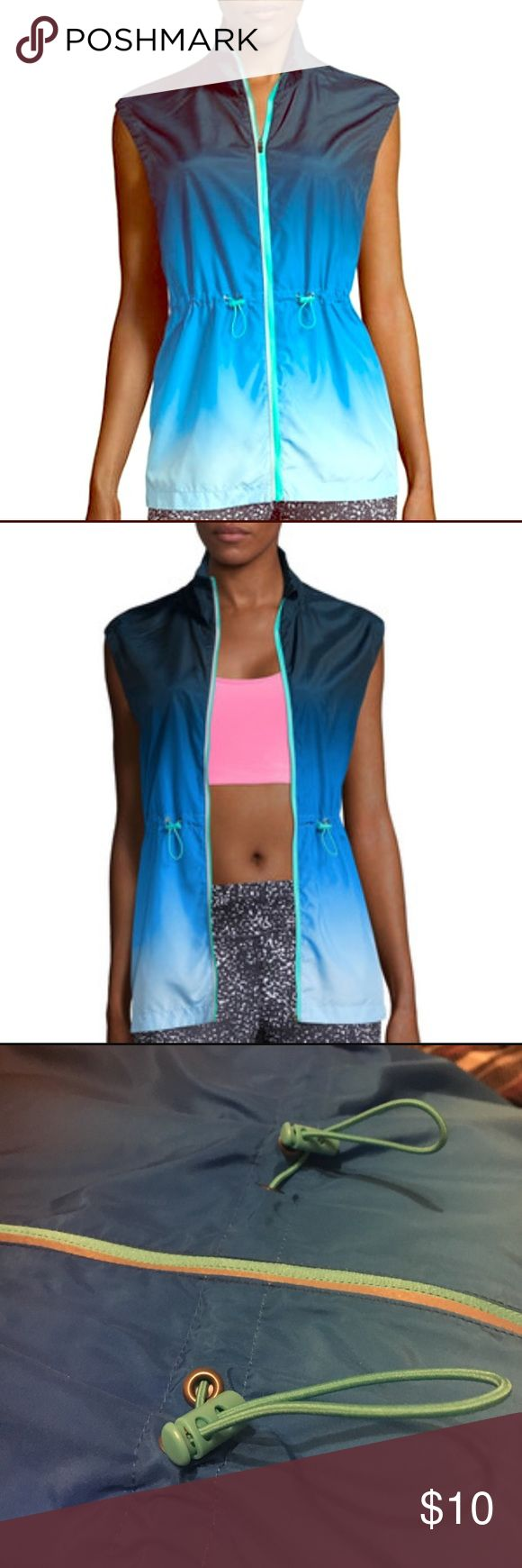 Workout vest top A super cute faded blue vest. Can be worn unzipped or zipped. Intended for workout purposes. Never worn before. xersion Jackets & Coats Vests