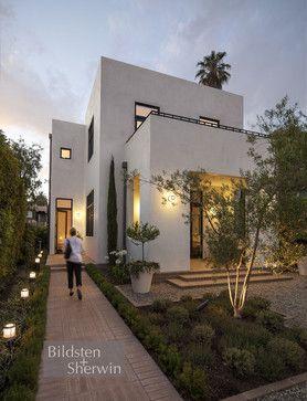 Exterior - white stucco w/dark window frames and door.