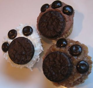 "Pupcakes (Could also be bear paws)  Ingredients: Your favorite cupcakes  Icing, Mini York Peppermint Patties,   Jr. Mints Candies  Flaked Coconut (optional, if you need some ""fur"")  Directions:  Frost cupcakes with your choice icing, depending on what color ""paws"" you want."