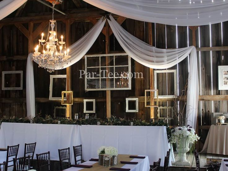 Rustic Wedding Featuring Custom Ceiling and Backdrop Draping