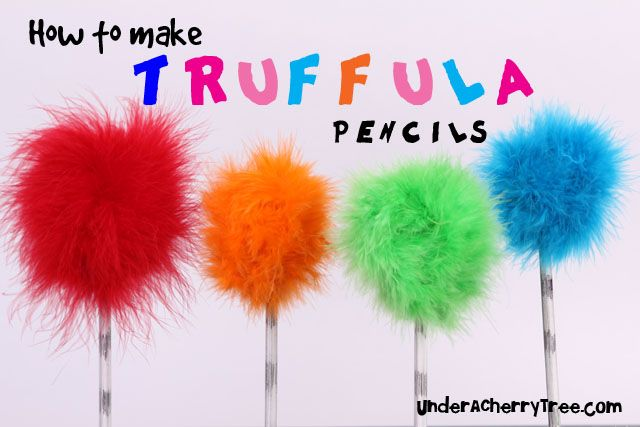 Under A Cherry Tree: How to make Truffula Pencils  I did my own version with a pen and six black rubber bands.  Then made colorful pom poms out of yarn  hot clued onto the pen top.  Guest were able to write with their trees :D