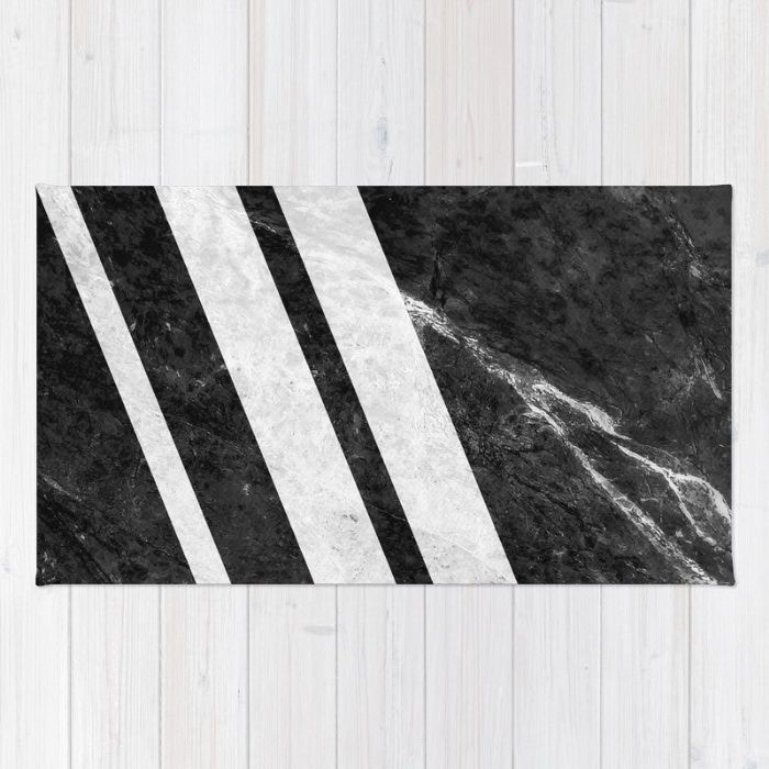 Digital design with stripes of white marble over a background of black marble with white pattern. #marble #stone #texture #pattern #black #white #stripe #striped #rug #homedecor
