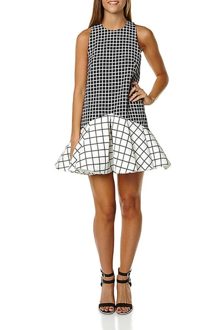 The Why Ask Dress is a bold drop waist dress with a feminine simplicity to each end. The dress has a high neckline with contrasting deep armholes. The dress features a darted bodice then complimented by a pleated skirt giving a flirty vibe along side the bold Checkered Print offered by Cameo. the dress has a keyhole button closure at the back along with a half hidden zipper at the waist.    Why Ask Dress by Cameo . Clothing - Dresses - Printed Louisiana