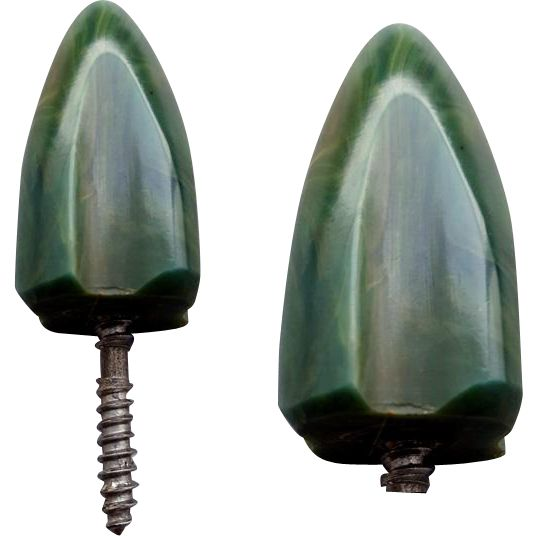 Vintage carved Bakelite drawer pull or knob in green with swirls of blue moon is shaped like a rocket. Measures: 2-3/4 long. Tapered Bakelite is about