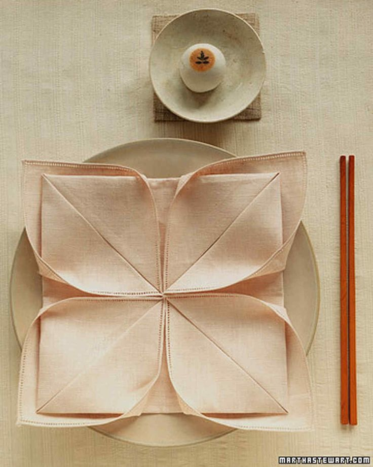 The art of napkin-folding is something fun and useful for every day. Folded napkins can both serve a practical purpose -- tucking in utensils, completing the theme in the place setting -- and offer decorative flair. To inspire you, we present a dozen ways to spiff up a plain napkin.
