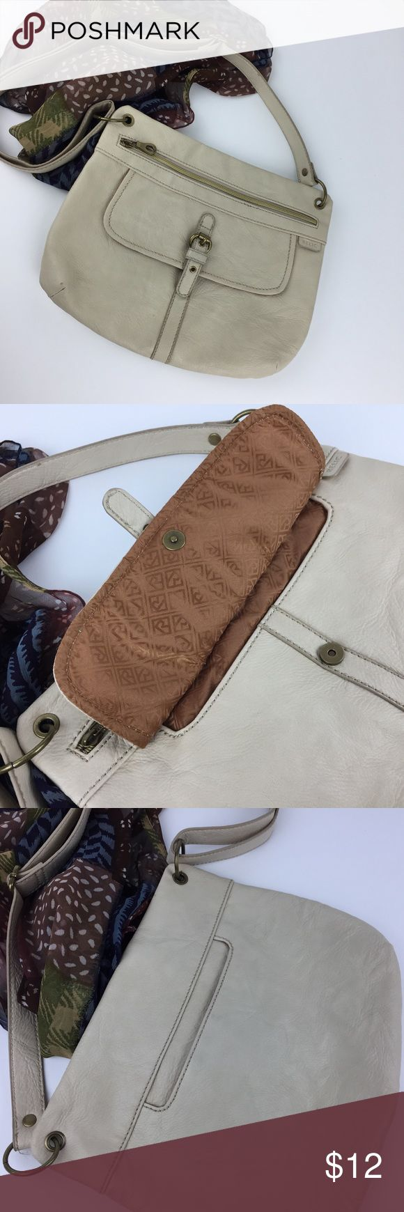 Relic Faux Leather Beige Shoulder Bag 12X10. A beige shoulder bag by Relic. Faux leather with a long adjustable strap. 2 outside pockets and a zippered main opening. Clean inside. 12x10x2 Relic Bags Shoulder Bags