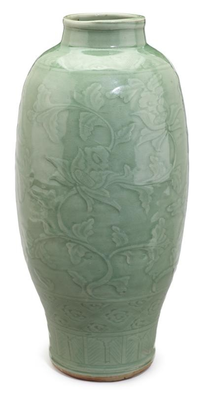 Chinese celadon vase     ming dynasty     Slender vase with underglaze carved scrolled foliate decoration.     H: 15 in.