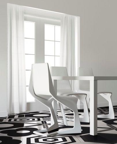 Carrelage hexagonal, les plus belles inspirations pour le sol et pour les murs par Maison Créative. Ici carrelage hexagonal à motifs noirs et blancs au look résolument contemporain. Disponible chez David B.