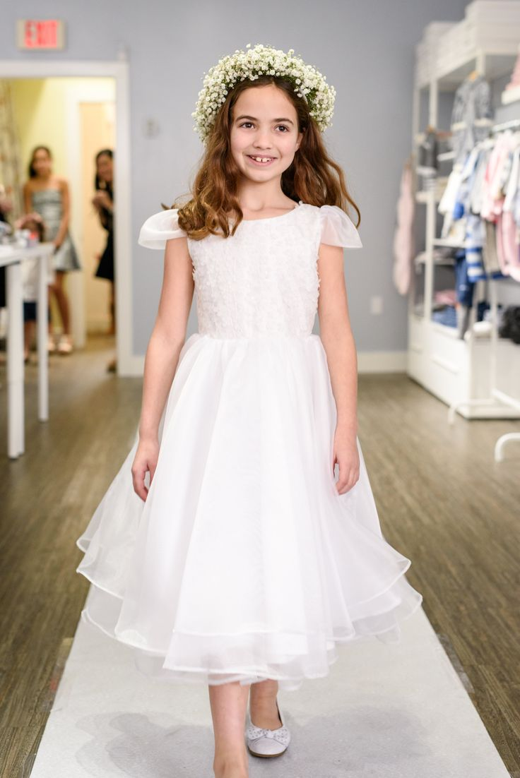 Emily looks radiant in this First Communion dress by Stella M'Lia! How Beautiful! The dress is a limited edition that is exclusively available at Ella & Henry.   N. Lalor Photography, BOW & ROSE #FirstCommunion #CommunionDress #SpecialDay #White #Spring #GirlsWithFlowers #FlowerCrown #Bloom #NewCanaan #NewCanaanCT #CT #Connecticut #FairfieldCounty