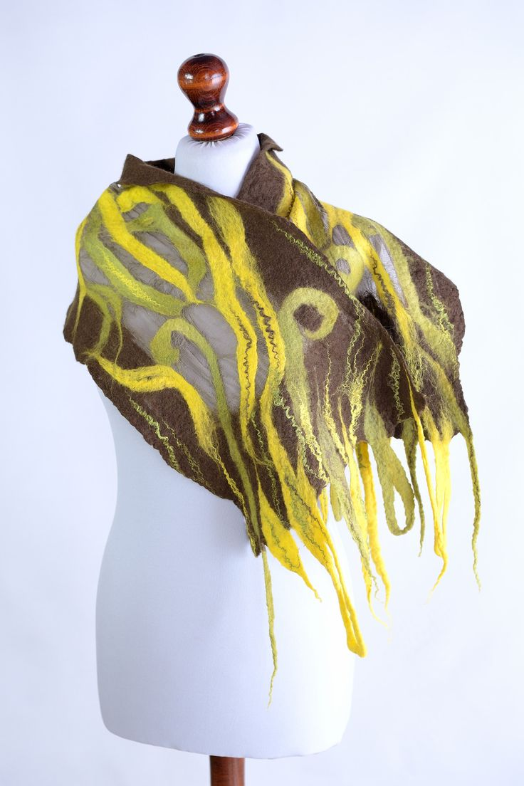 Nuno felt autumn scarf in brown, yellow and green with lightweight design. A unique breathable accessory perfect for temperate climate. #nuno_felt_scarf #scarf #silk_scarf #fall_scarf #autumn_scarf #fall #autumn #accessories