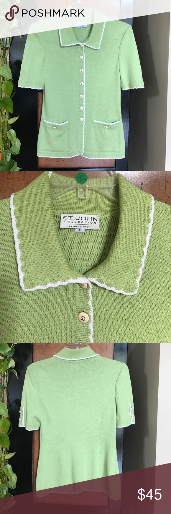 """St. John SZ 4 Lime Green short sleeve knit top Pretty St. John Collection by Marie Gray lime green with white trim Santana Knit short sleeve top in size 4.  Cream and gold logo buttons.  18"""" across underarms, 15.5"""" across waist, 26"""" long.  One small hole in right pocket, otherwise in very good used condition. St. John Tops"""
