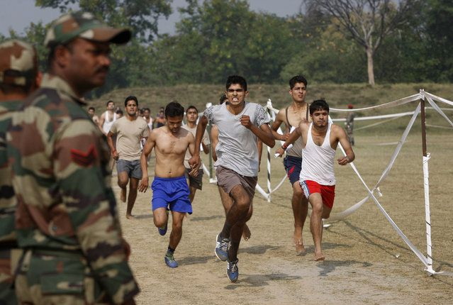 Candidates run during an Indian army recruitment rally at Sunjwan Military station on the outskirts of Jammu, India, Friday. (Photo by Channi Anand/AP Photo)