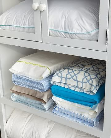 Ideas & Inspiration for Organizing and Putting Together a Linen Closet:  organize sheets by tucking them in one of the pillow cases