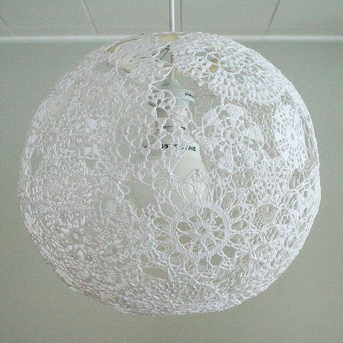 This is fab!  It's made like those cool string lights that were big in the 70's. It's where you use a balloon, fabric hardener, string (or in this case, a beautiful  crochet pattern & a light kit.  So cool!  I may have to make one!