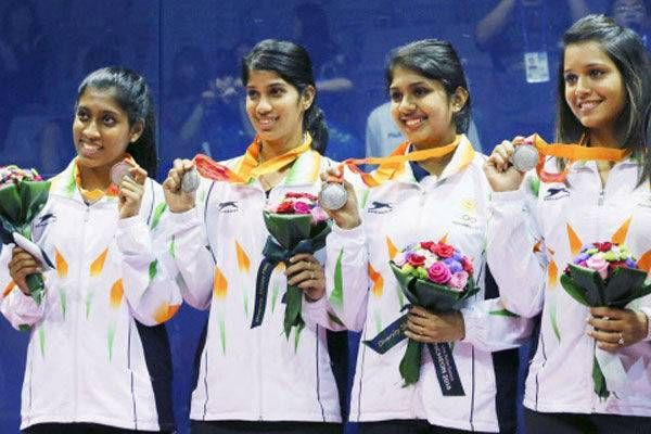 Photo - Day 8 action @ Asian Games  Anaka Alankamony, Joshna Chinappa, Aparajitha Balamurukan and Deepika Pallikal pose with their silver medals during the women's team squash award ceremony