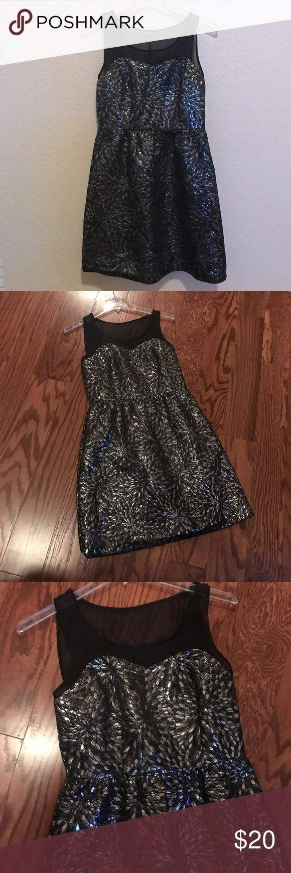 Elle black and silver dress! Metallic & beautiful Gorgeous party dress in black and silvetr metallic bus sheer topped gorgeous . worn once in like new  condition no damage no stains no rips' no snags zipper back light weight Elle Dresses