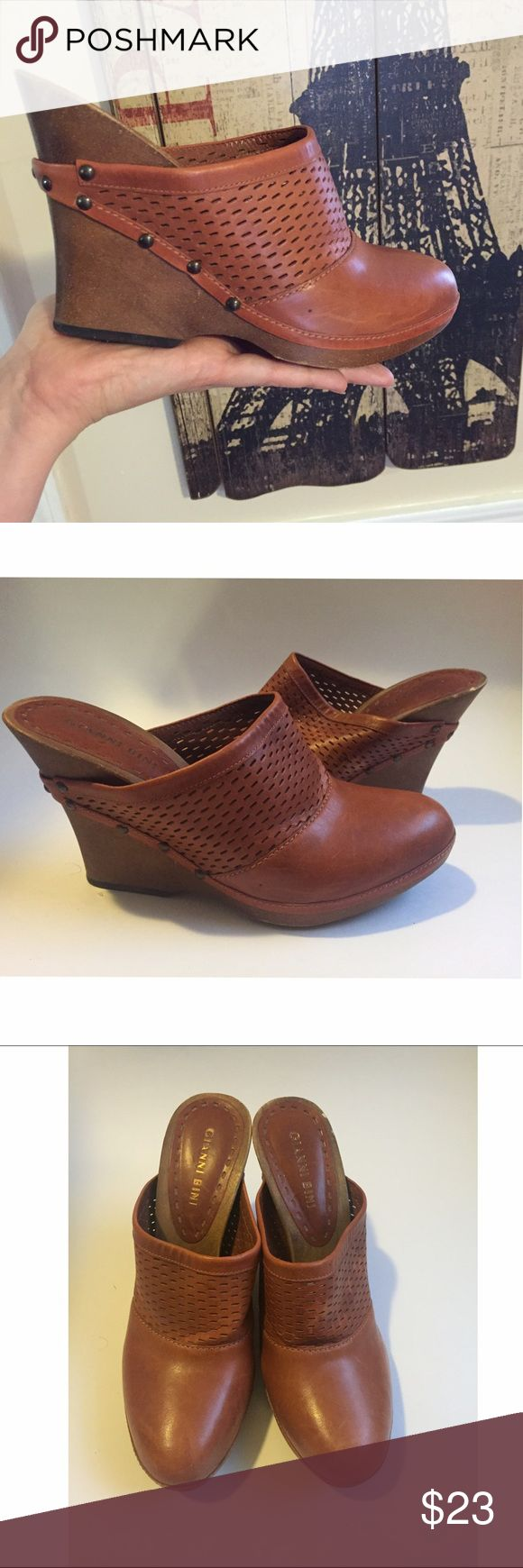 Clogs wood wedges Gianni bini clogs wood wedges Some details on the wood part Condition: light worn Color: brown  Brand: Gianni bini Size; 8 Tag for searches; wedges, wood wedges, Gianni bini, Gianni bini shoes, Gianni bini wood wedges , clogs , Gianni bini clogs Gianni Bini Shoes Mules & Clogs