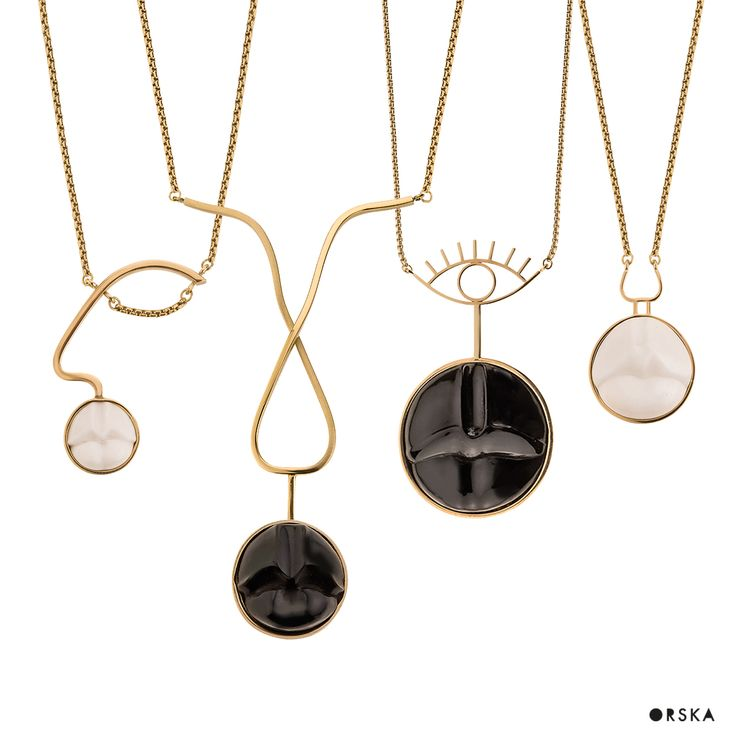 Lips-shaped necklaces, looking like misterious faces. BALI collection by Anna Orska.