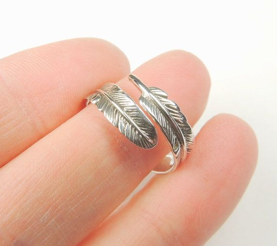 Sterling silver Feather Wrap ring,    *adjustable to fit sizes 6-9 only*  Sterling silver with a lot of feather details  and some tarnishing.