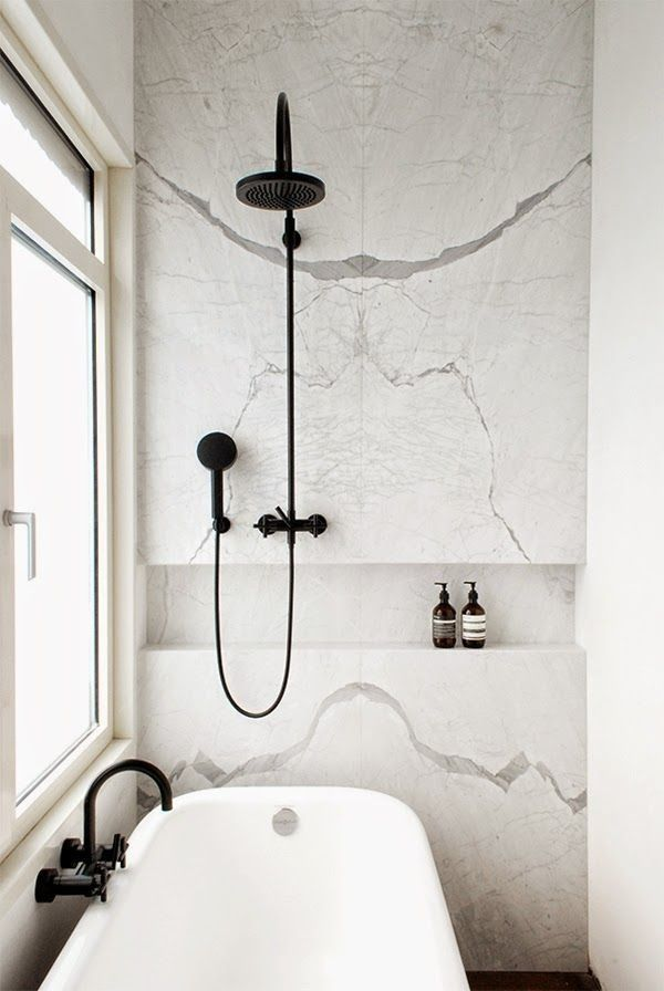 Black Dornbracht Shower Head and Plumbing Fixtures, White carrara marble, black and white bathroom | Remodelista