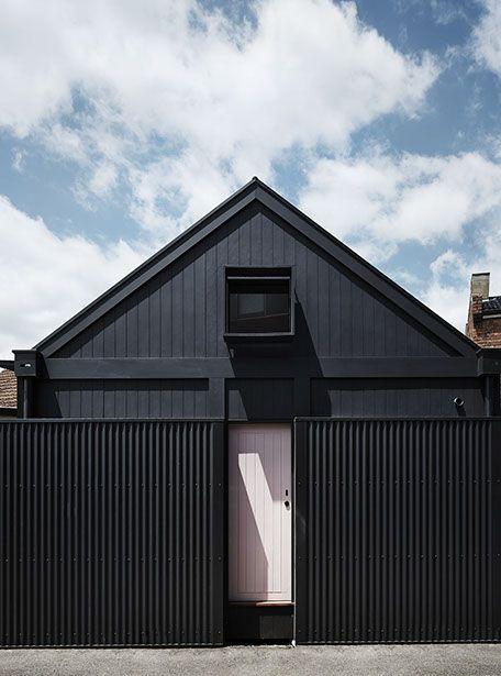 black house exterior & fence, pink door