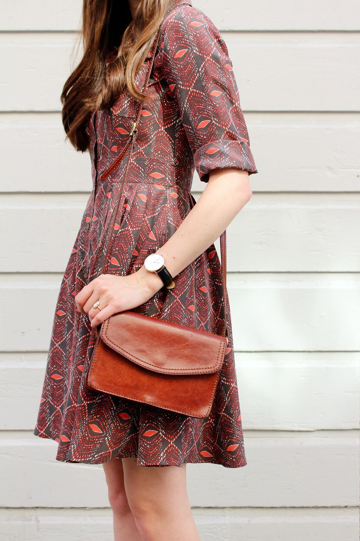 Lovely cut to the dress and I love the bag and watch pairing with it.