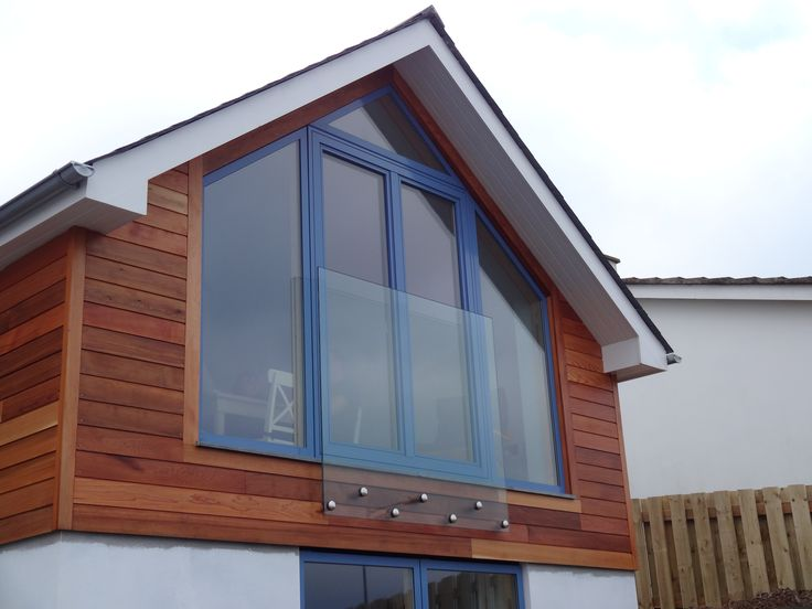 Frameless glass boss fixed Juliet balcony with 15.5mm laminated glass (Polzeath Cornwall)