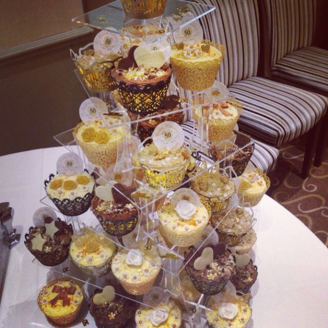 Golden wedding anniversary cupcakes to go with the cake