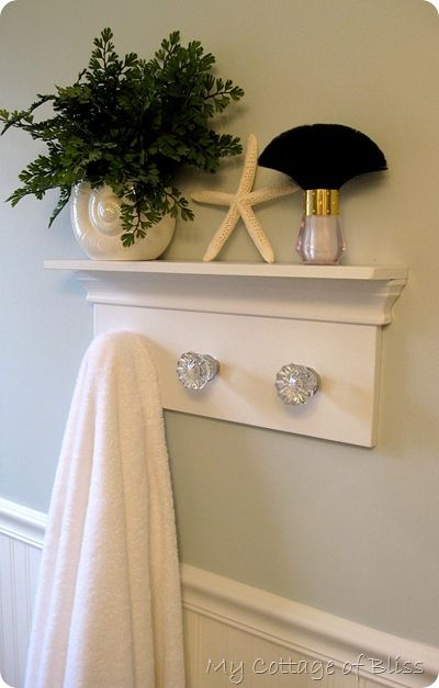 DIY towel rack~ this doesn't go to an instructional website however, I have put these crystal knobs on a wooden window frame type mirror in my office and they are a hit. I bought them on ebay.
